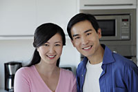 Couple smiling together in kitchen - Alex Mares-Manton
