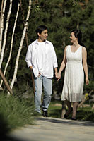 Young couple walking together outdoors - Alex Mares-Manton