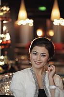 Head shot of elegantly dressed woman with diamond jewelry at night - Alex Mares-Manton