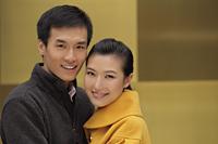 Head shot of smiling young couple hugging - Alex Mares-Manton