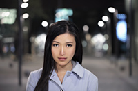 Head shot of young woman on the street at night - Alex Mares-Manton