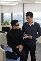 Two men working together in office - Alex Mares-Manton