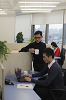 People working in an office together - Alex Mares-Manton