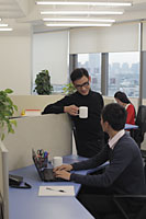 Three people working in an office - Alex Mares-Manton