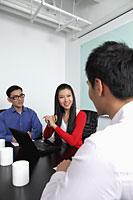 Three people having a meeting - Alex Mares-Manton