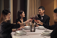 People toasting during a dinner party - Alex Mares-Manton