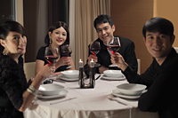Young people drinking wine at a dinner party - Alex Mares-Manton