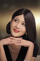 Head shot of a beautiful woman wearing diamond jewelry - Alex Mares-Manton