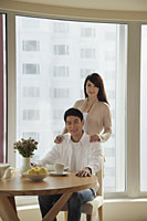 Young couple together in their condo - Alex Mares-Manton