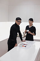 Man and woman dressed in black working in modern office - Alex Mares-Manton