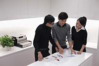 Three people working together in modern office - Alex Mares-Manton
