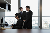 Businessmen working together in office - Alex Mares-Manton