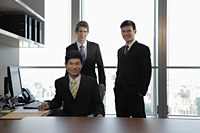 Three businessmen working together in an office - Alex Mares-Manton
