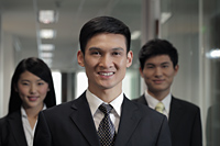 Head shot of three businesspeople in office - Alex Mares-Manton