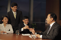 People smiling during a business meeting - Alex Mares-Manton