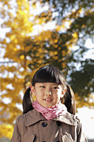 Head shot of young girl in coat outdoors - Alex Mares-Manton