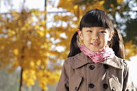 Head shot of young girl wearing a coat outdoors - Alex Mares-Manton