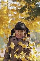 Autumn leaves falling on young girl - Alex Mares-Manton