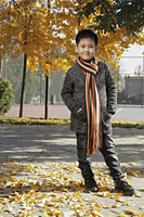 Young boy wearing sweater and scarf outdoors - Alex Mares-Manton