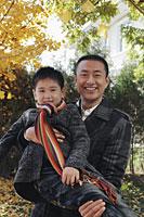 Dad holding his son outdoors - Alex Mares-Manton