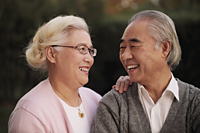 Older couple looking at each other and smiling - Alex Mares-Manton