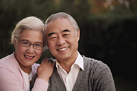 Head shot of older couple smiling together - Alex Mares-Manton