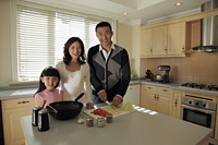 Young family cooking together in the kitchen - Alex Mares-Manton