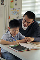 Father helping son with his homework - Alex Mares-Manton