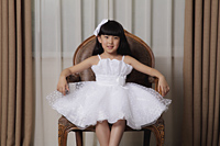 Young girl dress up in white dress sitting in nice chair - Alex Mares-Manton