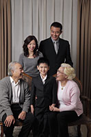 Three generation family dressed up laughing together - Alex Mares-Manton