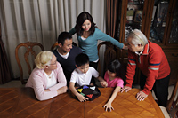 Three generation family playing Chinese checkers together - Alex Mares-Manton