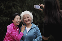 Two older women smiling while having their photo taken - Alex Mares-Manton