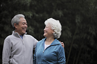 A senior couple looking at each other smiling - Alex Mares-Manton