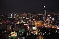 Aerial view at night of Ho Chi Minh city with Bitexco Financial Tower in the background, Vietnam - Alex Mares-Manton