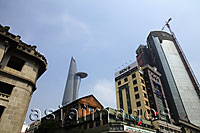 Old and new buildings with Bitexco Financial Tower in background. Ho Chi Minh, Vietnam - Alex Mares-Manton