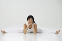 Woman practicing yoga - Asia Images Group