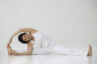 Woman in practicing yoga - Asia Images Group