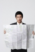 Man with map - Asia Images Group