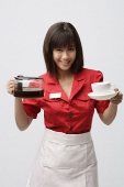 Waitress serving coffee - Asia Images Group