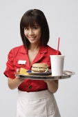 Waitress serving meal - Asia Images Group