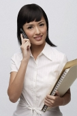 Secretary with files and mobile phone - Asia Images Group