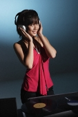 Young woman DJ - Asia Images Group