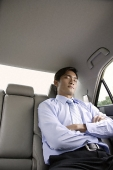 Businessman asleep in backseat of car - Asia Images Group