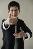 Man in martial arts pose - Asia Images Group