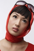Portrait of woman wearing red sweater, scarf and sunglasses - Asia Images Group