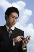 businessman using hand held device - Asia Images Group