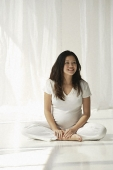 Pregnant woman doing yoga - Asia Images Group