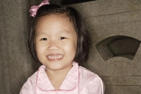 Little Chinese girl smiling - Asia Images Group