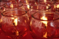 Close up of candles at temple altar - Asia Images Group