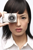 Woman holding camera - Asia Images Group